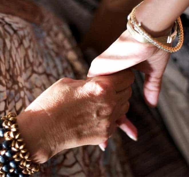 women at retreat holding hands